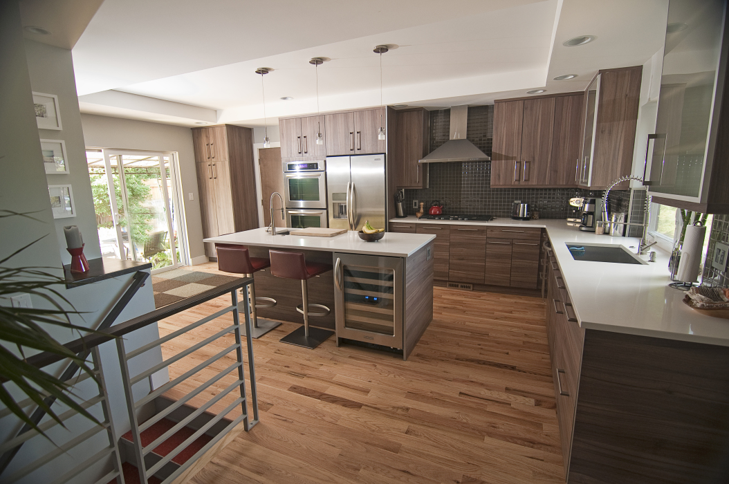 Hardwood Flooring And Simple Clean Lines Make This Kitchen